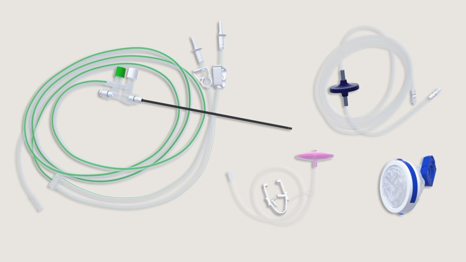 collection of laparoscopic pack components: camera cover, insufflation tube, smoke filter