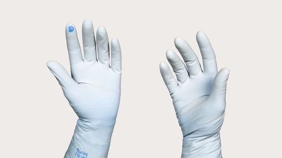 Gloved hand with puncture indication
